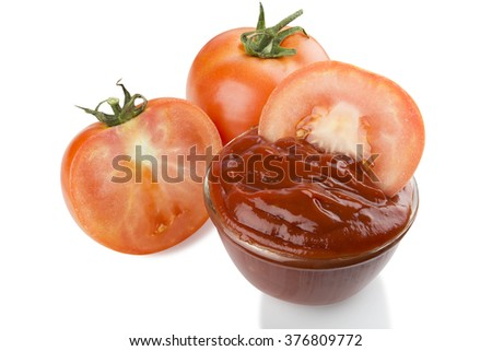 slice tomato in Glass Bowl with tomato sauce and  red tomatoes  isolated on white background.With clipping path.