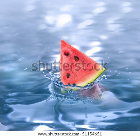 slice watermelon falling in a refreshing drink - stock photo