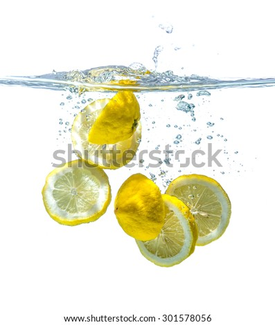 slice yellow lemon in water, motion action.