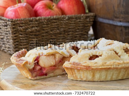 Sliced apple cranberry pie on a wooden platter