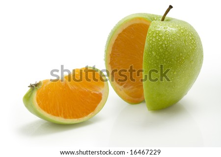 Sliced apple with moisture and an orange center - stock photo
