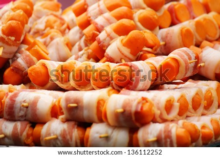 sliced bacon and sausage - stock photo