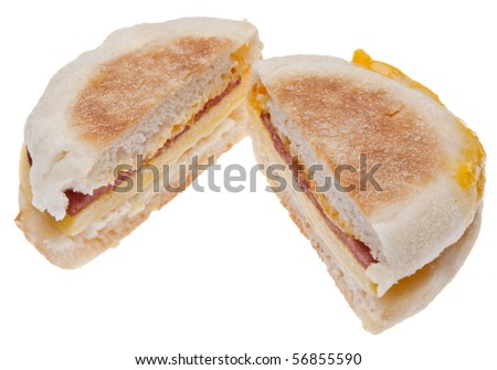 Sliced Bacon, Egg and Cheese Breakfast Sandwich Isolated on White with a Clipping Path.