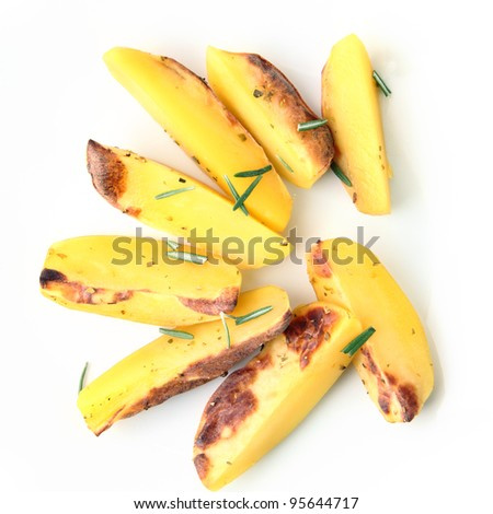 sliced ??baked potatoes with basil on a white background - stock photo