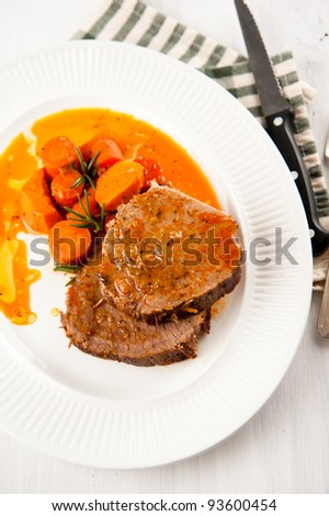 Sliced Beef Roast Served with Carrots and Yams - stock photo