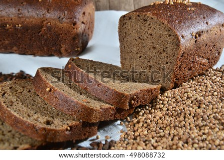 Sliced bread and seeds on textile close up