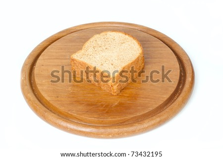 Sliced bread on round desk isolated on white background