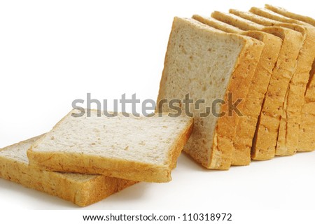Sliced brown bread isolated on white