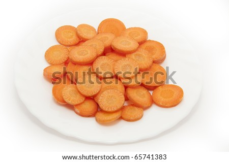 Sliced carrots in a white plate - stock photo