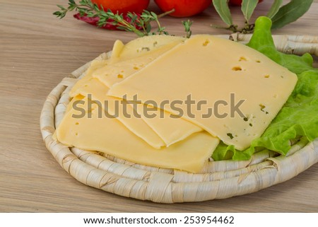 Sliced cheddar on the board with thyme