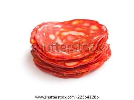 sliced chorizo salami on white background - stock photo