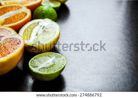 sliced citrus fruit on a black background. food