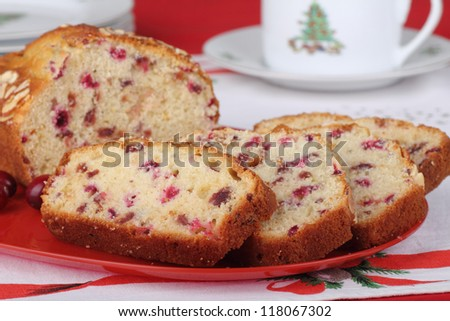 Sliced cranberry sweet bread on a red platter