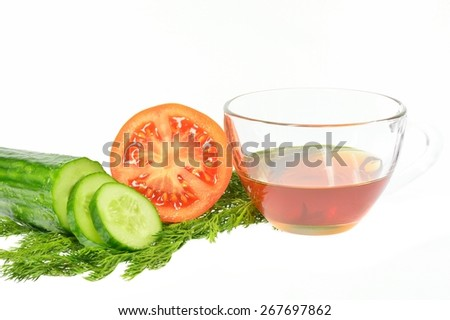 Sliced cucumber into slices next half tomato dill and sunflower oil cup on a white background - stock photo