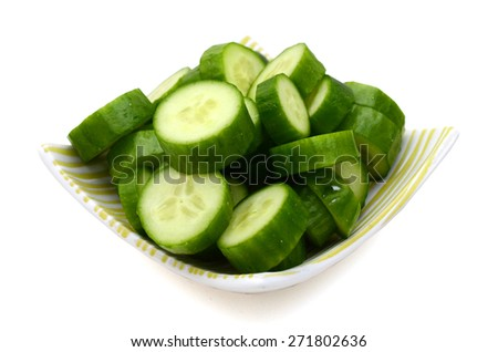 sliced cucumbers on plate isolated on white  - stock photo