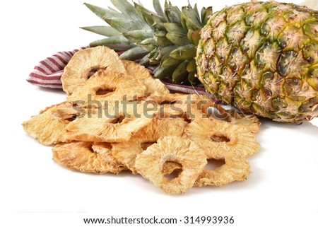Sliced dried pineapple on a white counter top - stock photo