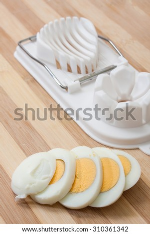 Sliced egg on the egg chopper.  - stock photo