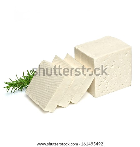 Sliced feta cheese with rosemary on white background - stock photo