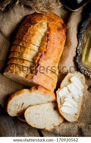 Sliced fresh bread on wooden background,vintage - stock photo