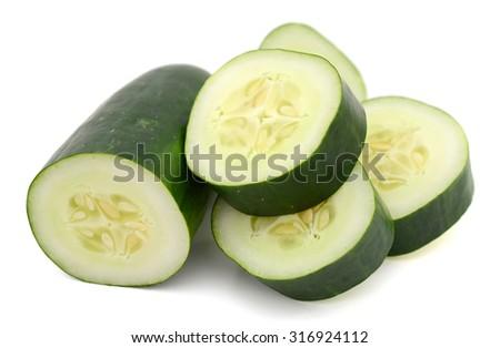 sliced fresh cucumber isolated on white background - stock photo