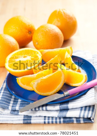 Sliced Fresh Juicy Navel Oranges on Plate - stock photo