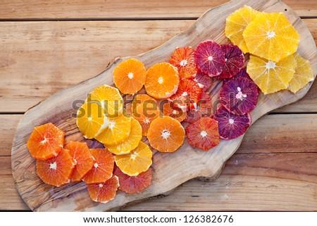 Sliced Fresh Juicy Oranges on cutting  board. 0 - stock photo