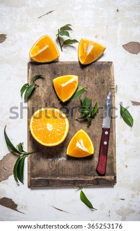 Sliced fresh oranges on the old board. On rustic background. Top view - stock photo