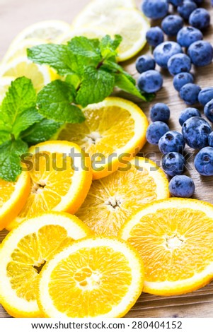 Sliced fresh organic fruits prepared to make infused water. - stock photo