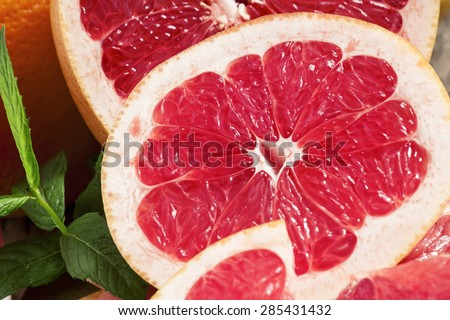 Sliced fresh pink grapefruit and ice, selective focus - stock photo