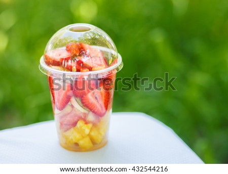 Sliced Fruits arranged in plastic cup