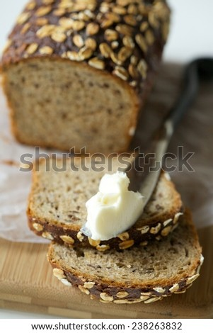 Sliced Grain Bread Front View with Butter - stock photo