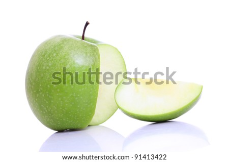 Sliced green apple on white.
