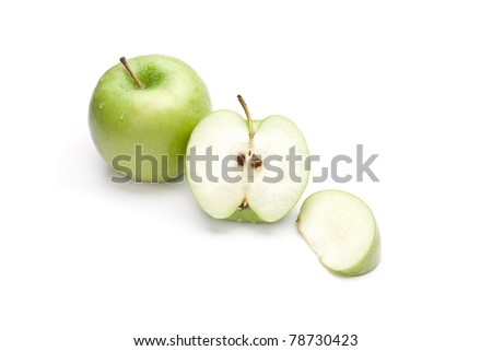 Sliced green apple with drops isolated on white - stock photo