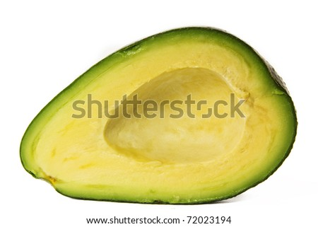 sliced green avokado half without seed - stock photo