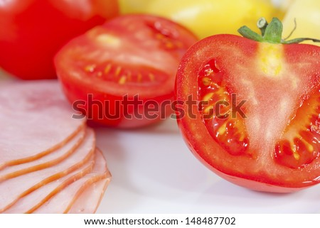 sliced ham, sweet peppers and tomatoes