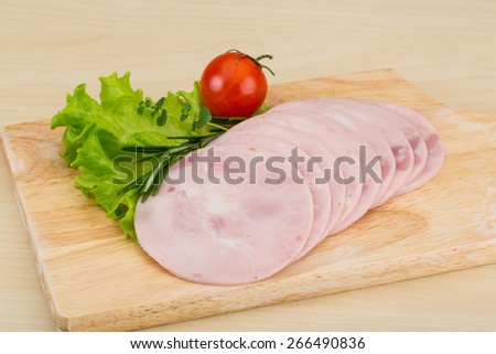Sliced Ham with rosemary on the wooden bckground - stock photo