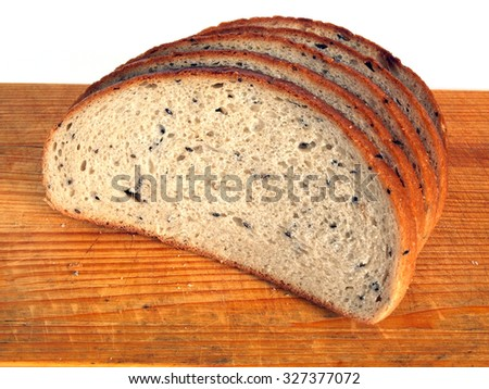 Sliced healthy lithuanian fine rye bread with grains and seeds on wooden cutting board white background close up.        - stock photo