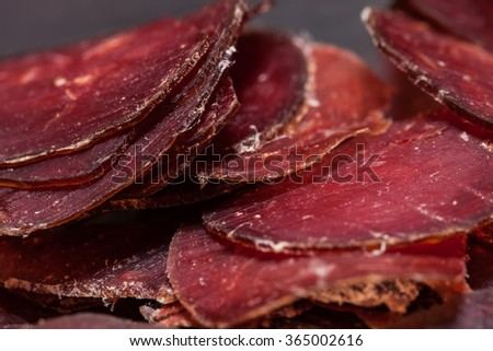 Sliced horse sausage. Selective focus. - stock photo