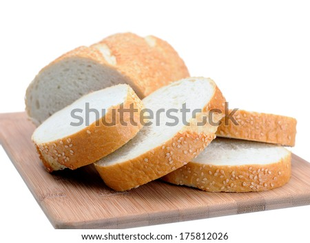 sliced Italian bread on cutting board isolated on white - stock photo
