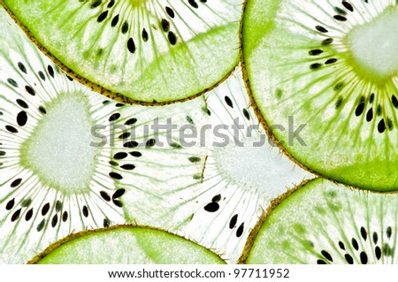 Sliced kiwi  in water isolated on a white background. - stock photo