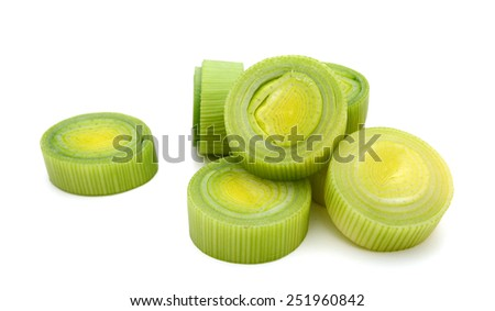 sliced leeks on white background - stock photo