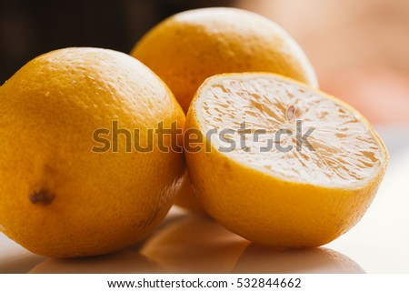 sliced lemon halves and a on blurred background closeup.