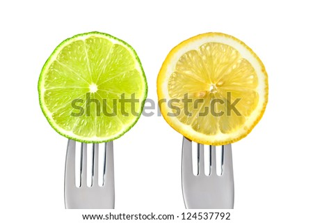 sliced lime and lemon of forks isolated against white background