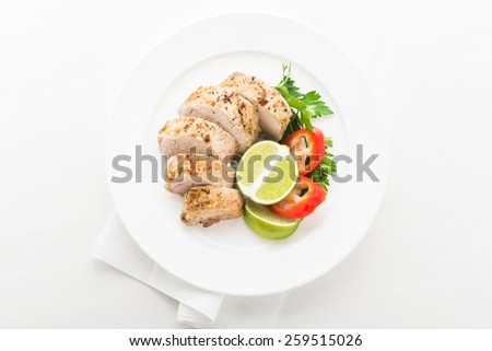Sliced lime pork tenderloin on white wooden background top view. Healthy food. - stock photo