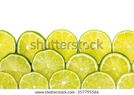 Sliced limes - isolated o white background - stock photo