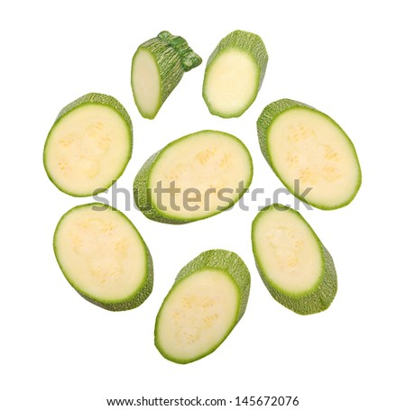 sliced marrow zucchini  isolated on white - stock photo