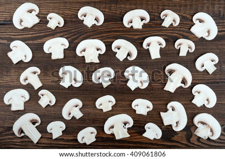 Sliced mushrooms on wooden rustic background. Food background. Top view  - stock photo