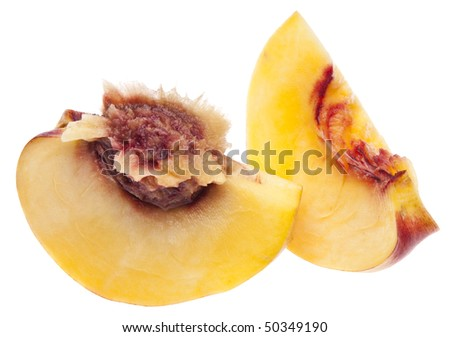 Sliced Nectarine with pit isolated on white with a clipping path.