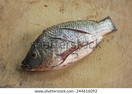 Sliced Nilotica Fish on chopping block wood