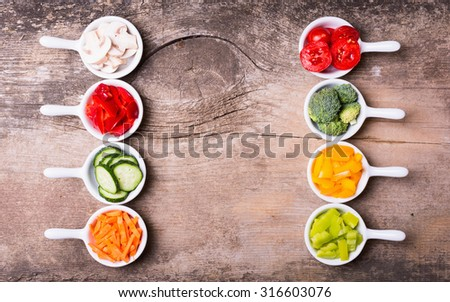 Sliced of vegetables ( broccoli, mushrooms, carrots, cucumbers, tomatoes and pepper ) - stock photo